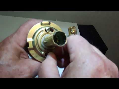 How to remove door knob with no visible screws.