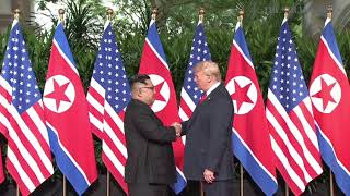 Trump-Kim summit: Donald Trump and Kim Jong Un exchange historic handshake