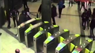 CCTV footage of a 15 year old girl getting 'body slammed' by ticket inspectors