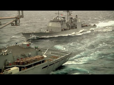 Aircraft Carrier USS Enterprise with Military Sealift to Combat support Ship