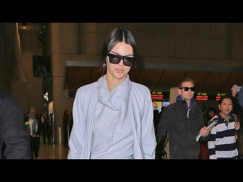 Fresh-Faced Kendall Jenner Rocks Grey Jumpsuit And Matching Overcoat At LAX