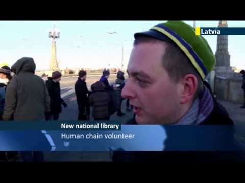 Latvians form human chain to move books to new National Library: Riga is European City of Culture