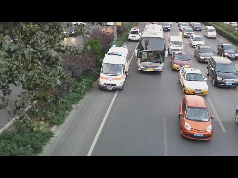 Police Escort Ambulance before and after .without sirens.Beijing