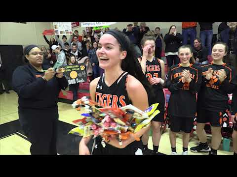 Mia Kelly of South Hadley High School scores her 1,000th Point