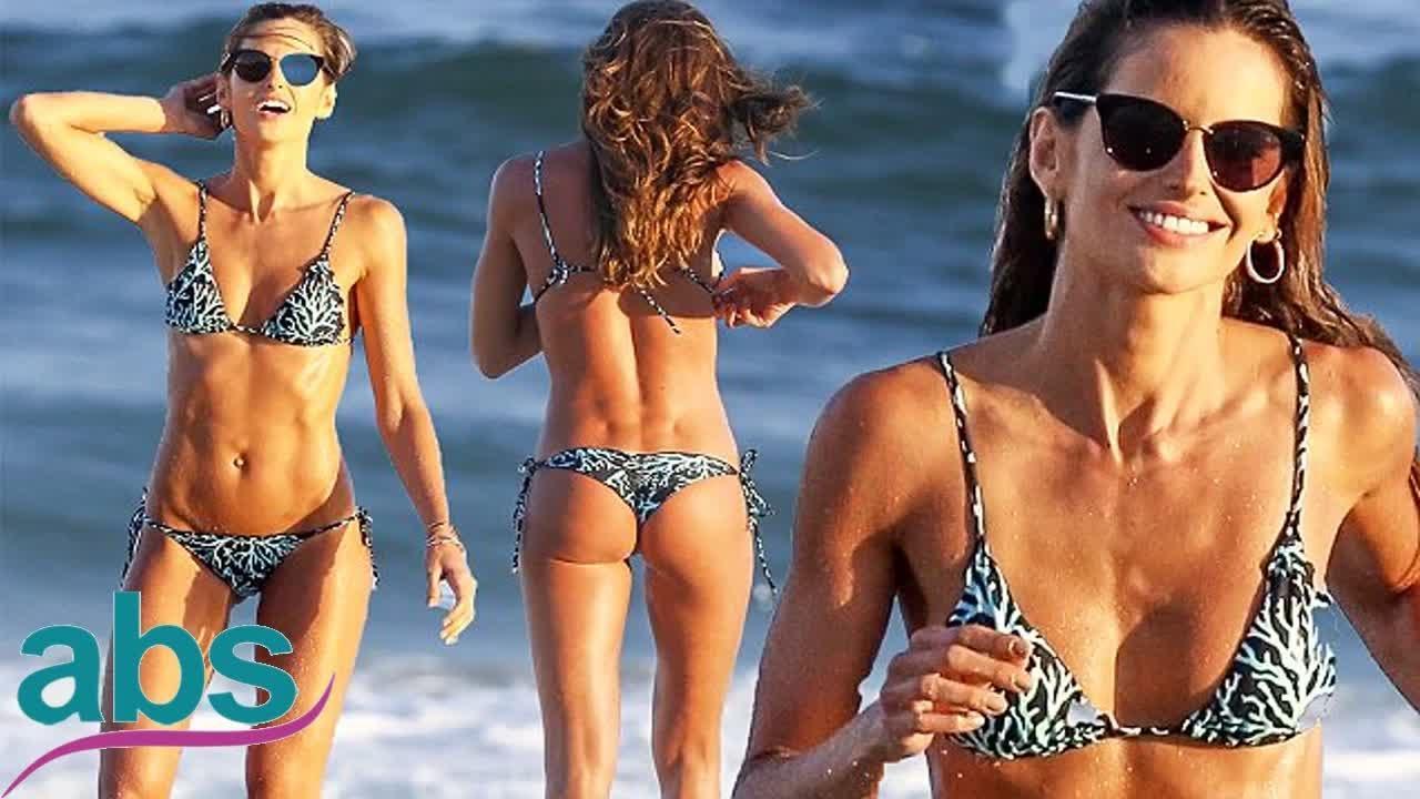 7d7a781372 Izabel Goulart flaunts sculpted midriff and derriere in tiny bikini ...