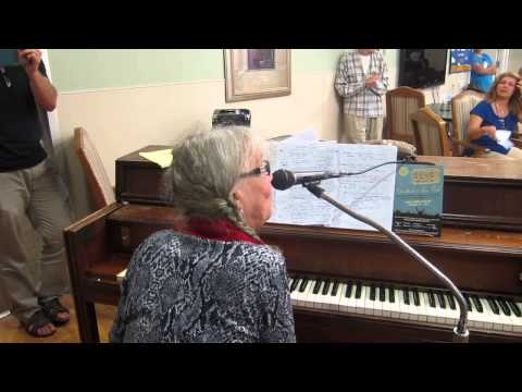 Michal Robins playing piano at the Jewish Home for the Aging