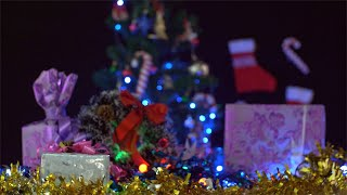 Tilt shot of a decorated platform with colorful Christmas items - festive scene