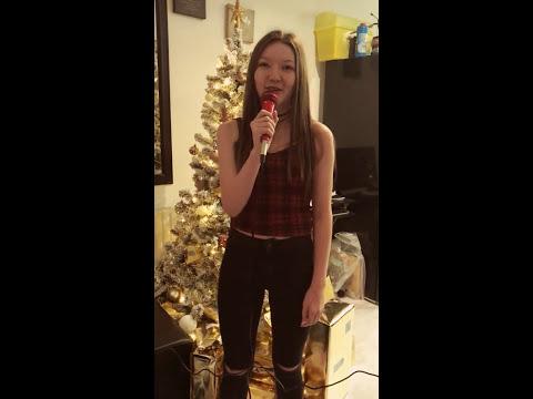 Faith Wilson rocking around the Christmas tree karaoke in the living room