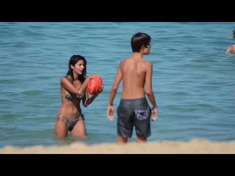 Pia miller plays afl with her 2 sons in a bikini at the beach