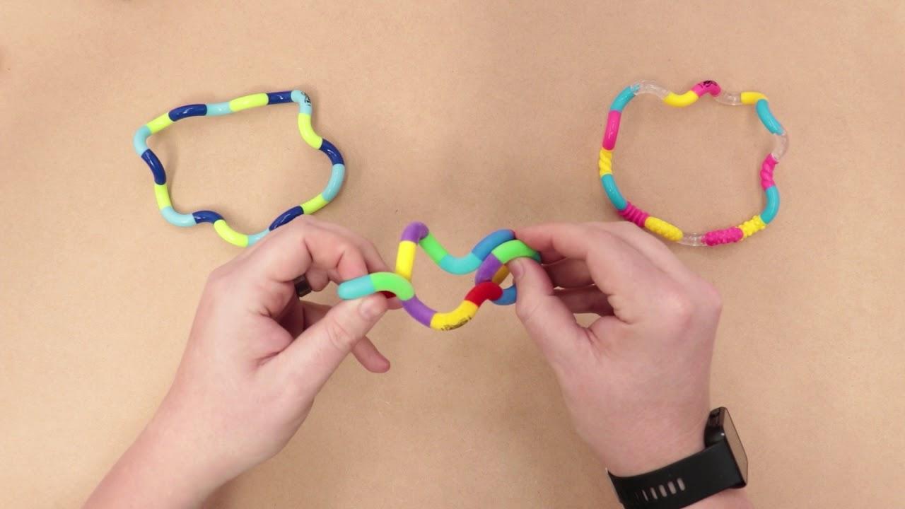 Резултат с изображение за tangle toy girl play