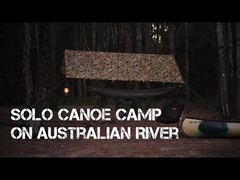 Solo Canoe Camp On Australian River