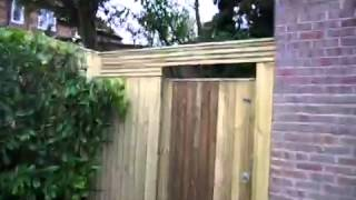 Contempory trellis, pedestrian gate and front of property f