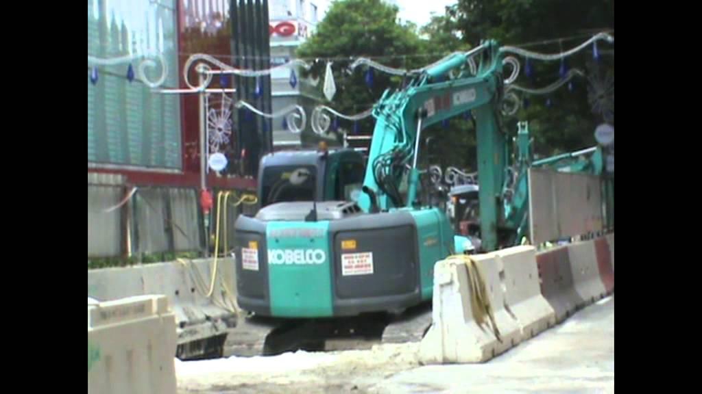 Excavator KOBELCO working in Singapore