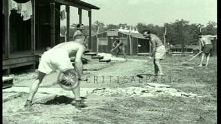 War camp prisoners fill in a road, Southern United States. HD Stock Footage