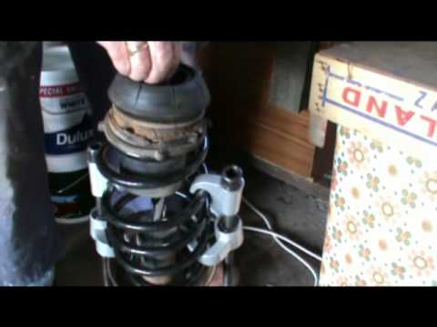 Replacing a front road spring on a Vectra B  YouTube