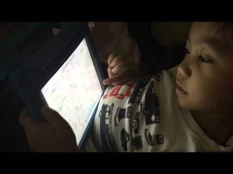 Three year old boy finding and naming the United States of America