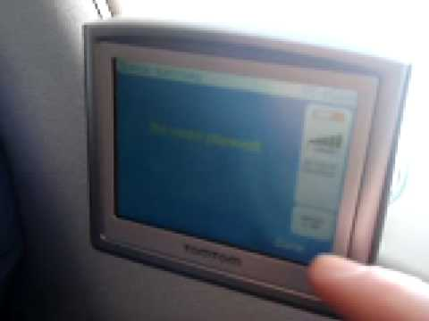 tomtom gps road navigation on a plane window, 438 mph