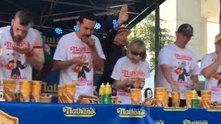 102-Pound School Superintendent Competitively Eats Hot Dogs During Summer Break