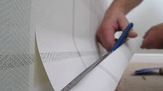 How to slide cut wallpaper with decorators shears