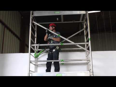 Energy absorbing fall arrest lanyard on scaffolding