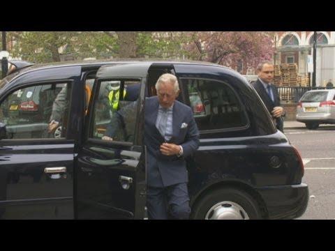 Prince Charles hails London black cab drivers