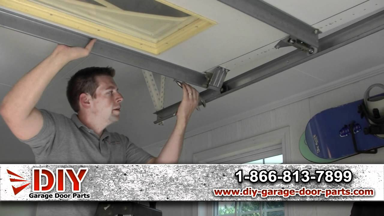 how to install garage door rollers