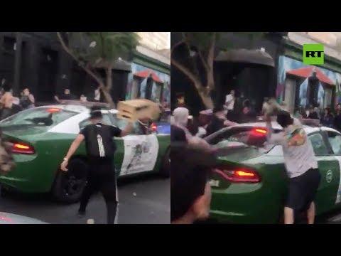 RT en Español: Atacan con piedras y elementos contundentes a una patrulla de Carabineros en Chile