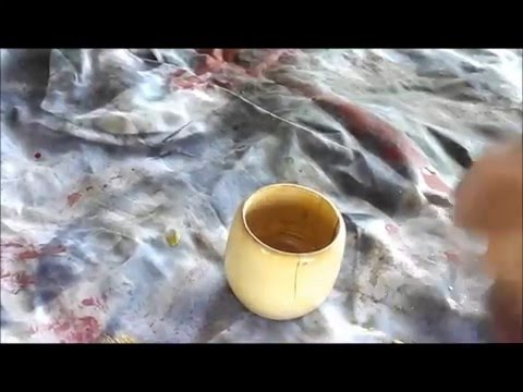 woodturning a small bowl / cup  out of a log.