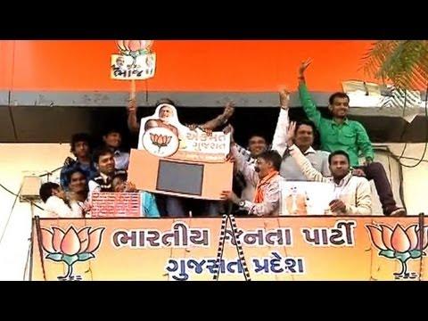 Supporters celebrate Modi's landslide win