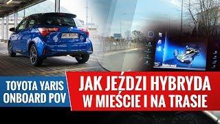Hybrydowa Toyota - jazda w mieście i na trasie z widokiem na monitor energii