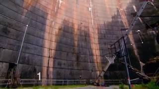 Watch what happens when a spinning basketball get thrown off a dam