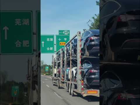 Download #Teslashanghai The truck with TESLA on the Shanghai-Chongqing Expressway, about 300 km from Shanghai