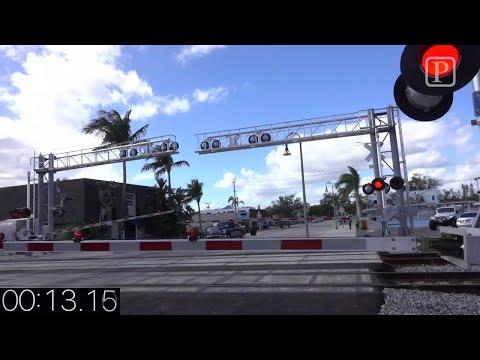 Video/ Brightline vs Freight Train- times to & thru a crossing.
