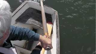 Sculling over the Stern
