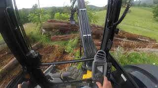 Deere 50G moving logs with hydraulic thumb GoPro!