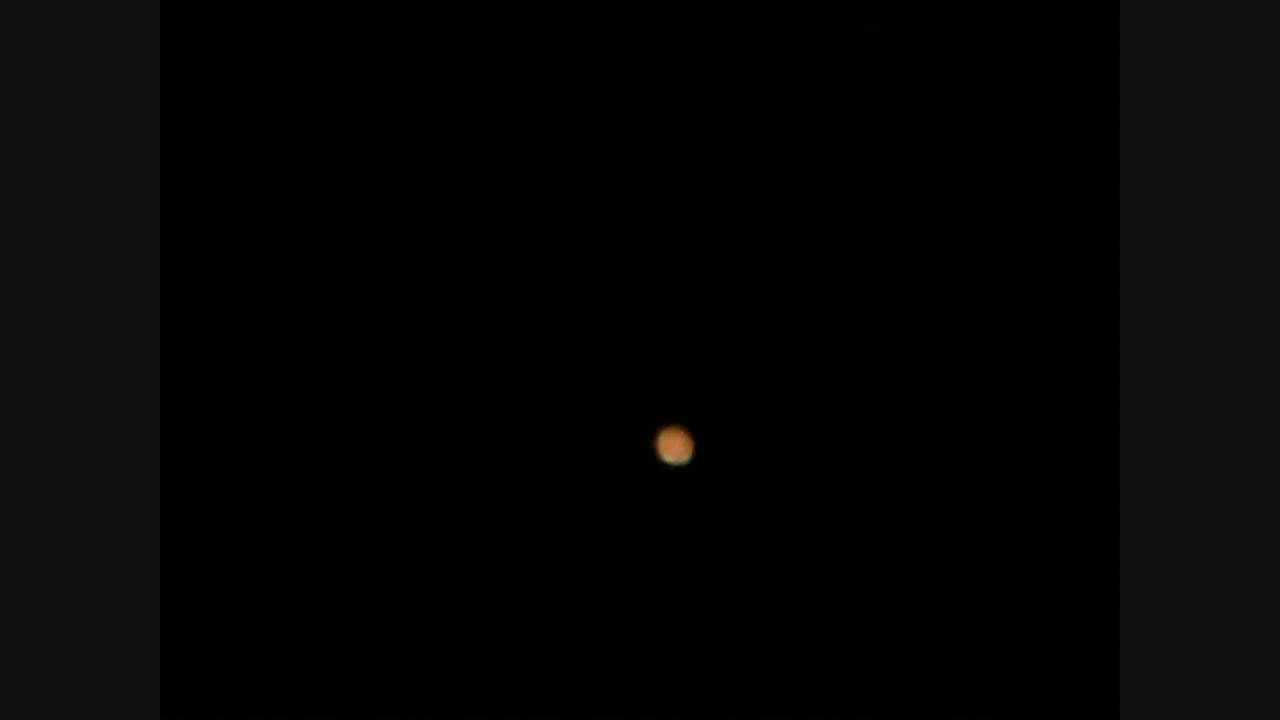 Mars Through a Telesco...