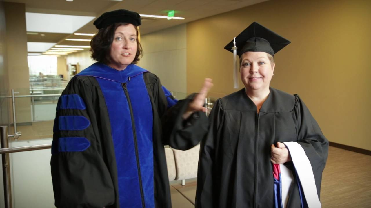 Putting on your cap, gown and hood for Shenandoah Commencement - YouTube