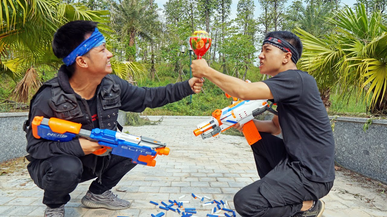 NERF GUNS WAR: Brother vs Brother LOLLIPOP BATTLE
