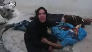 بالفيديو.. زوجة تبكي زوجها الذي استشهد في غارة جوية روسية على حلب