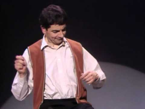 Rowan Atkinson Live - Star of Mr.Bean - Funny invisible drum kit sketch