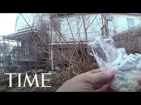 Download Youtube: Baltimore Cop Suspended After Body Camera Video Shows Him Planting Drugs On A Property | TIME