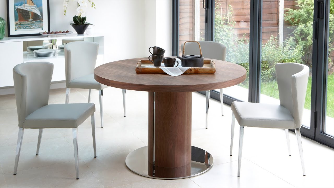 Round Wooden Extending Dining Table And Modern Chairs