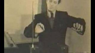 Leon Theremin playing his own instrument
