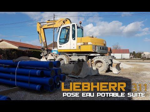 Pose Nouvelle conduite eau potable Liebherr 311 suite
