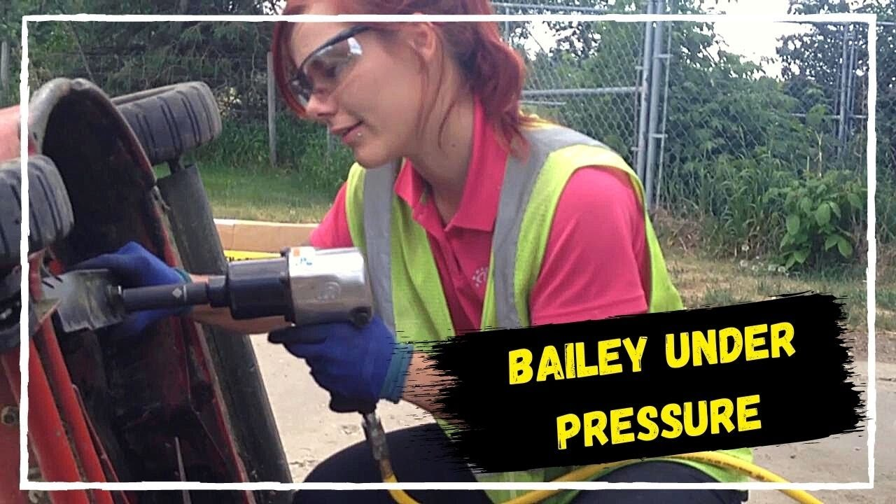 Bailey Is Changing Blades On Exmark Commercial 30