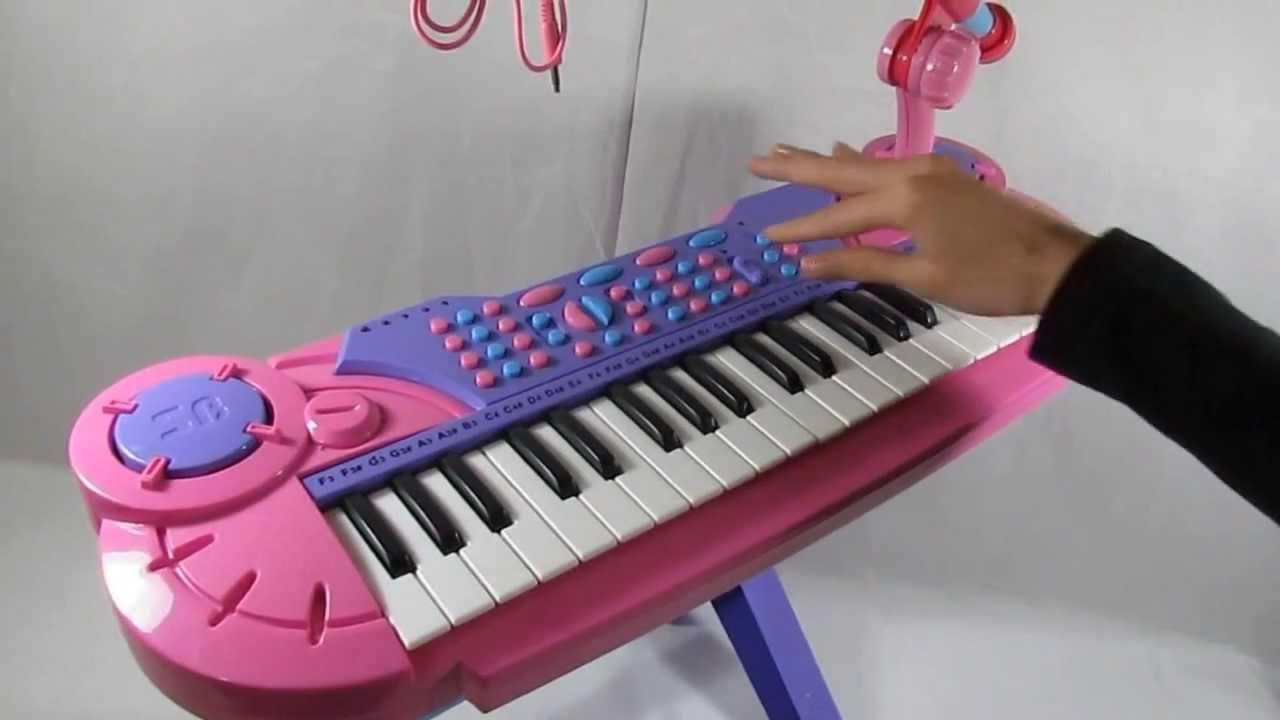 Organeta rosada para ni as con mesa y silla microfono for Mesas y sillas para ninas