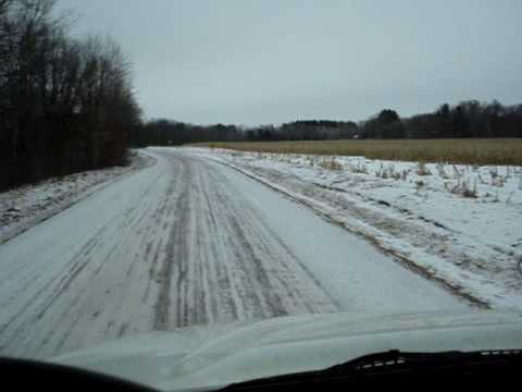 garbage truck  on a rural Minnesota  winter road.  KQRS