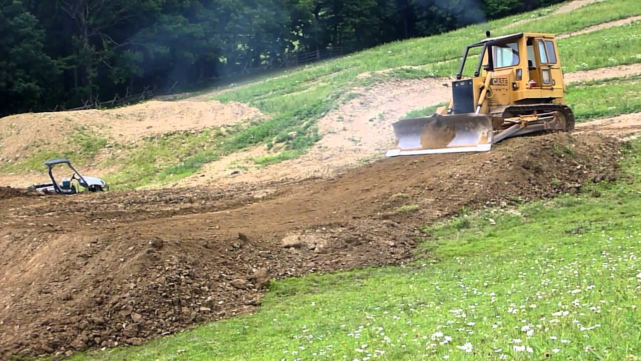 Case 1450 Building Motocross Track - YouTube