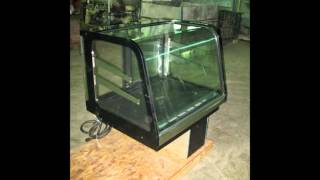 Genemco's Used Federal Industries Curved Glass Refrigerated Countertop Signature Series Display Case