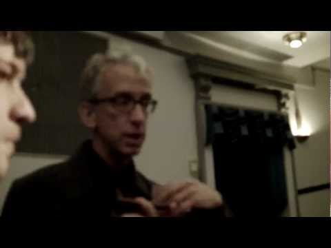 Andy Dick helps Ryan Young with a research paper